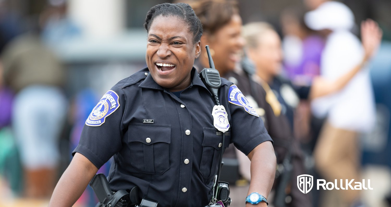 Smiling police officer working with off duty management